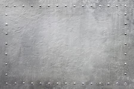 armour plating: Riveted military or industrial plate. Metal background. Stock Photo