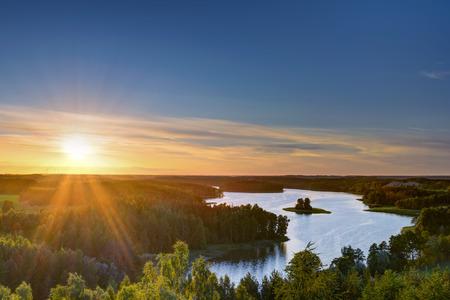 Sun sets over beautiful Jedzelewo Lake. Stare juchy, Poland.