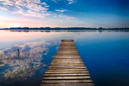 Empty footbridge over the lake Selment Wielki. Masuria, Poland.