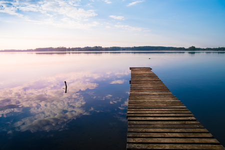 Empty footbridge over the lake Selment Wielki. Stock Photo