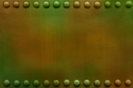 Riveted military or industrial plate. Metal background. Stock Photo