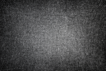 Black and white stretched canvas. Fabric texture with vignette.