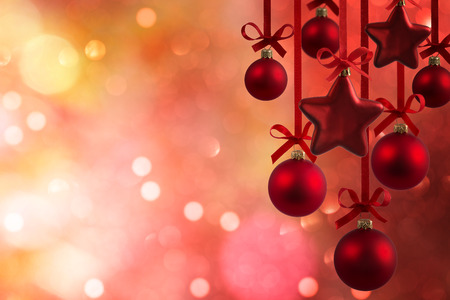 Christmas red balls with ribbons isolated on defocused background Stock Photo