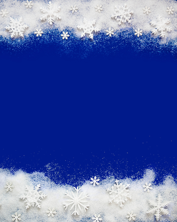 Christmas background with a decorative snowflake on artificial snow Stock Photo