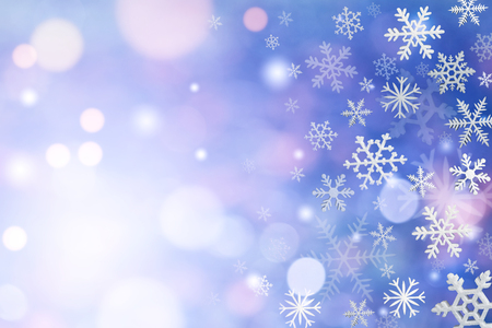 Christmas decoration with snowflakes on defocused blue background.