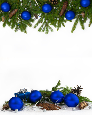 Christmas decoration  four-fifths with blue baubles, cones and gift on white background.