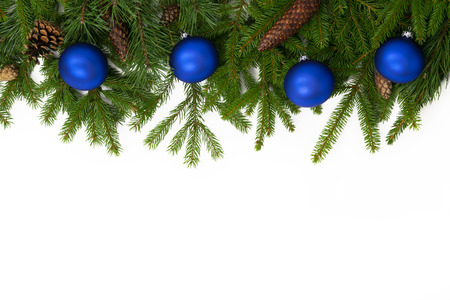 Christmas upper decoration with blue balls and cones  on white background. Stock Photo