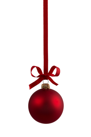 Red christmas bauble hanging on ribbon with bow, isolated on white.
