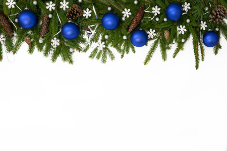 Christmas upper decoration with blue balls, stars  and cones  on white background. Stock Photo