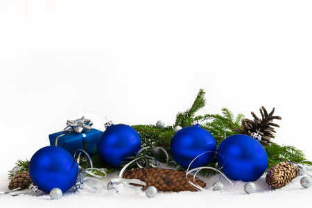 Christmas lower decoration with balls; stars; cones and gift on white background.