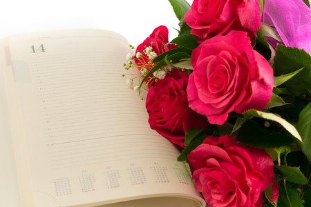 Valentines day deoration with calendar and pink rose.