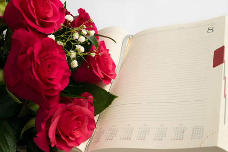 Womens  day  decoration with calendar and red roses.