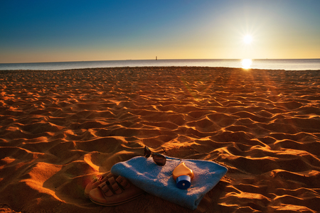 Towel on hot sand and landscape of sea