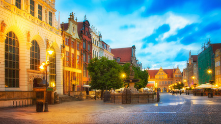 Beautifully illuminated Old Town in Gdansk with Neptunes statue. Poland, Pomerania.