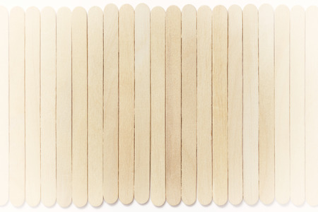 Retro background made of wooden ice cream sticks. Front view. Stock Photo