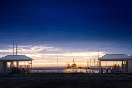 Entrance to the pier in Sopot at dawn. Sopot, Pomerania, Poland.