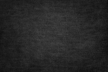 Black jeans texture. Dark fabric background. Stock Photo