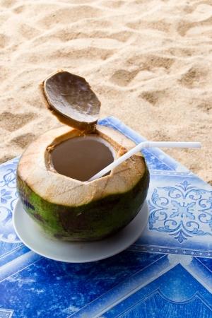 Coconut juice on the beach photo