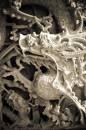 stone carving of dragon photo