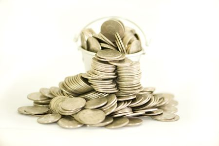 a bucket of coins Stock Photo