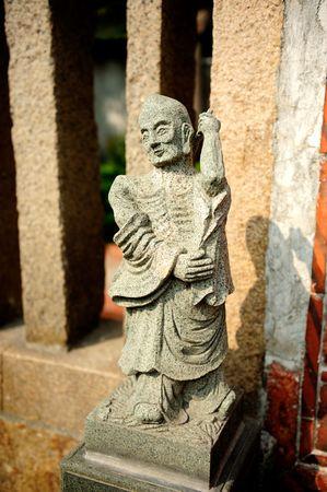 chinese stone statue of buddha photo