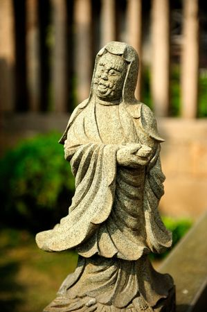 chinese stone statue of buddha Stock Photo
