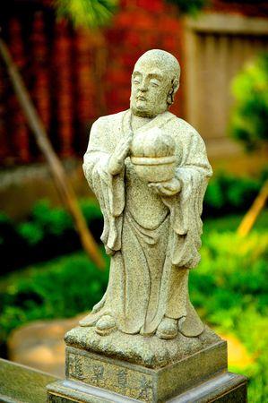 chinese stone statue of buddha Stock Photo