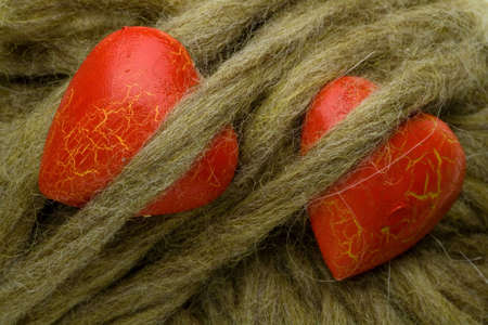 splendour: Two red hearts in the wool cobweb