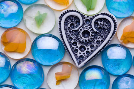 The white ivory heart is among the color glasses photo