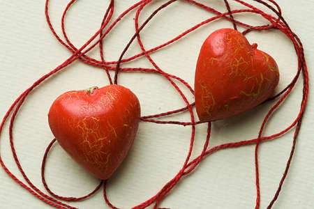 The red heart lie in the thread cobweb photo
