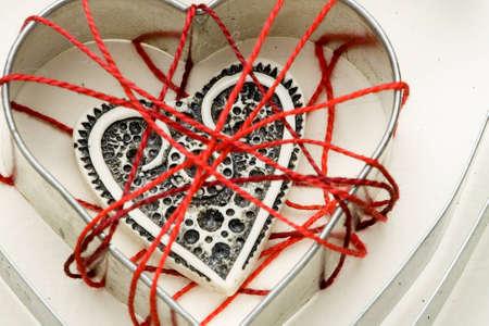 Ivory heart shape inside cotton cobweb Stock Photo - 4131701