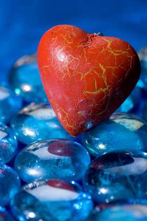 Red heart shape on blue glasses Stock Photo - 4131675