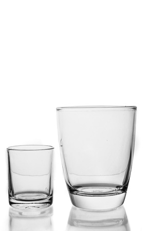 Pair of water glass and differenr size in isolated background. photo