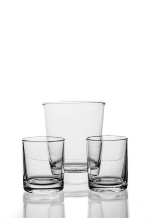 Group of water glass and differenr size in isolated background. photo