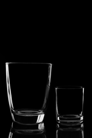 bar ware: Pair of water glass and differenr size in isolated black background.