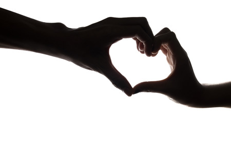 silhouette hands in the form of heart in isolated background. photo