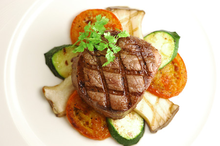 charbroiled: Grilled Thick Filet mignon served with king oyster and tomatos