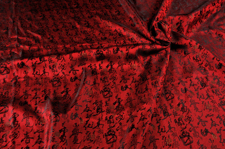Chinese Calligraphy silk. Chinese style. Red silk background. Beautiful red Satin Fabric for Drapery Abstract Background