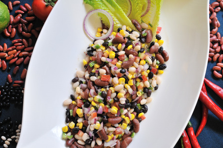 mexican food. kidney bean with tomato salad.