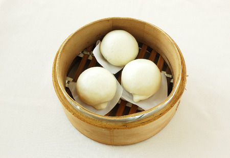 yumcha. dim sum in bamboo steamer with chinese bun, pao, bao zi, steamed dumpling, shumai on table in chinese restaurant. chinese cuisine.