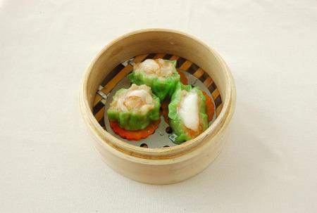 shu: yumcha. dim sum in bamboo steamer with chinese bun, pao, bao zi, steamed dumpling, shumai on table in chinese restaurant. chinese cuisine.