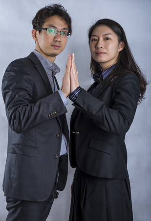 next to each other: Confident Asian business couple standing next to each other