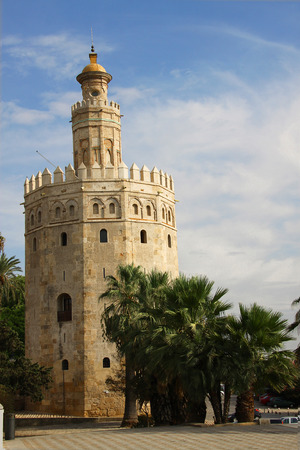 place of interest: Gold Tower at sunset in Seville, Spain