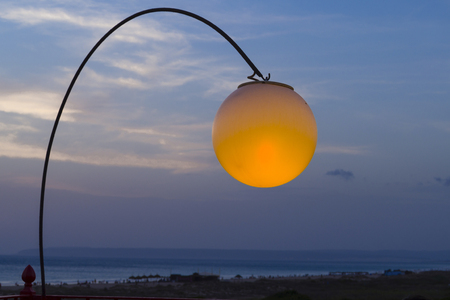 dusky: Lamp lit with the sunset on the beach of Zahara, Cadiz. Spain Stock Photo