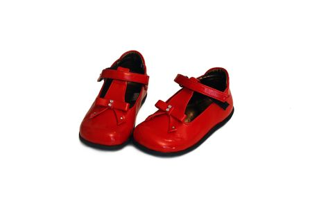 a pair of red baby shoes photo