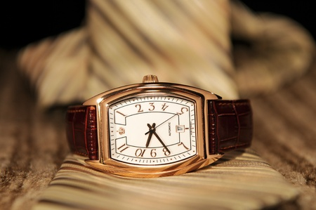 Golden watch with a business tie