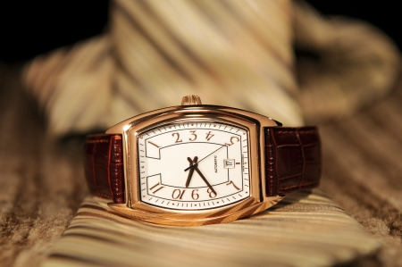 Golden watch with a business tie Stock Photo - 12878511