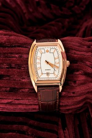 Golden watch on a velvet textile