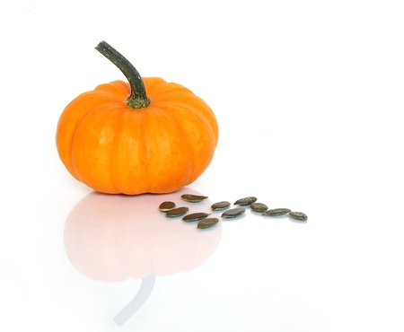 Mini Pumpkin with seeds, isolated with copy space