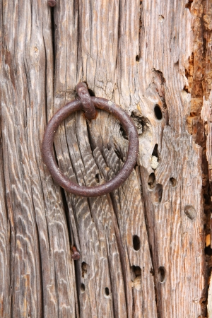 Old Door Ring on a Wood Door photo